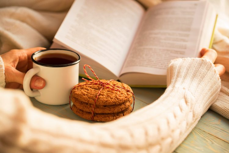 Cookies next to coffee and a book
