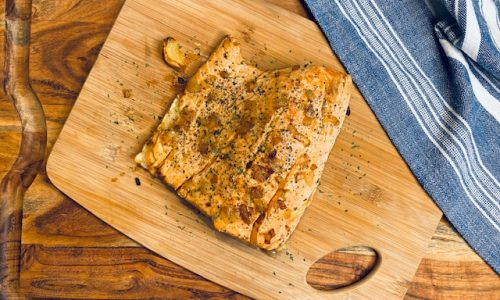 Cooked salmon on cutting board