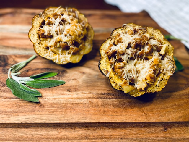 Cut in half acorn squash with stuffing on cutting board