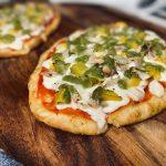 Chicken salsa verde pizza on wooden board