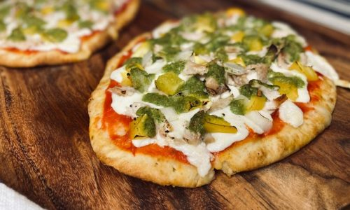 Chicken salsa verde pizza on wooden board