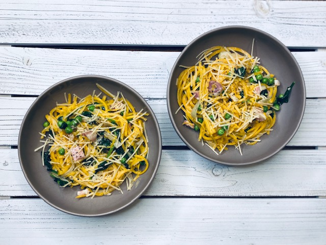 Butternut squash carbonara in bowls on white wood