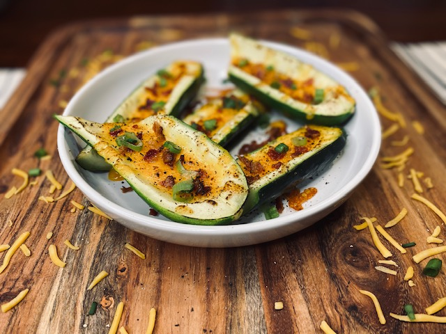 Zucchini with cheese and bacon