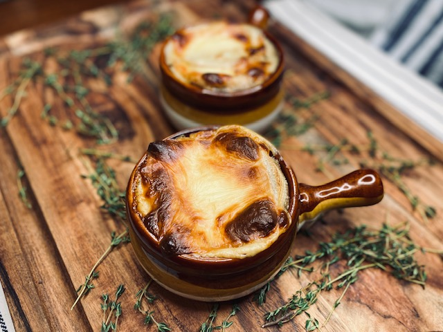 French onion soup on wooden board