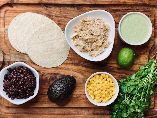 Ingredients on wooden board for tostadas