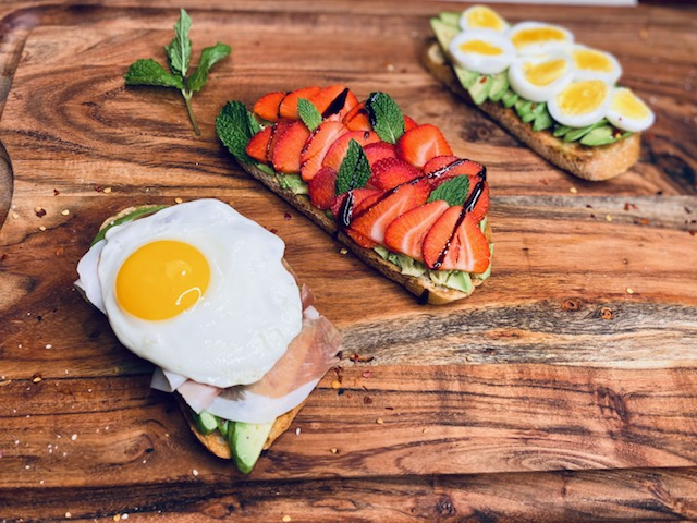 Avocado toast with eggs and strawberries