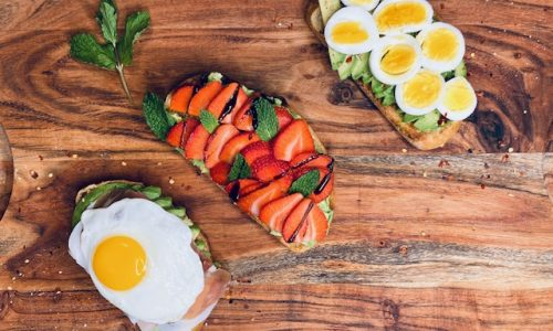 Avocado toast 3 ways on a wooden board