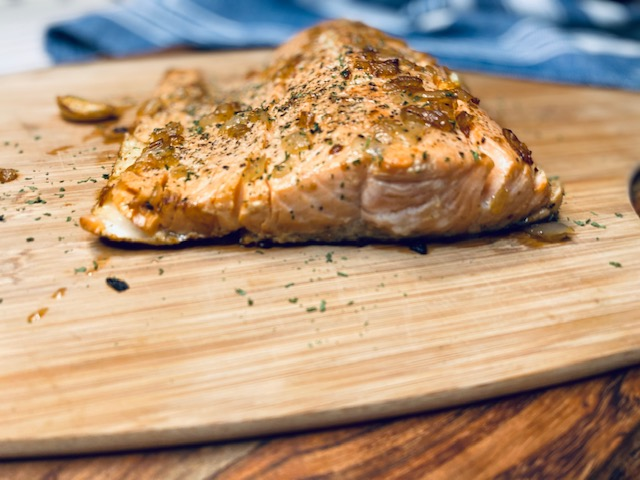 Cooked salmon on cutting board