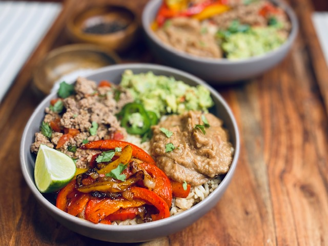 Mexican burrito bowls on a wooden board