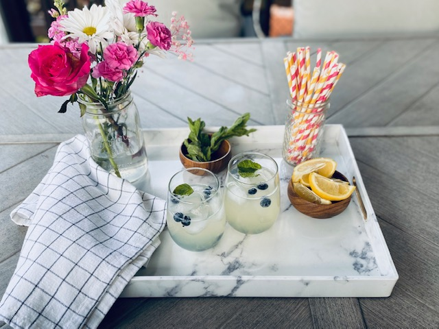 Marble tray with cocktails and flowers