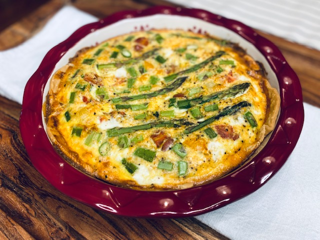 Quiche on a wooden board