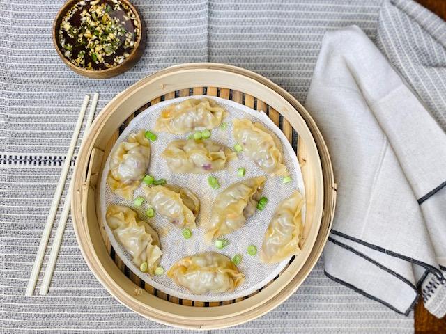 Pork dumplings in a bamboo steamer