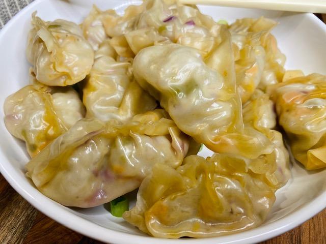 Steamed dumplings in a white bowl