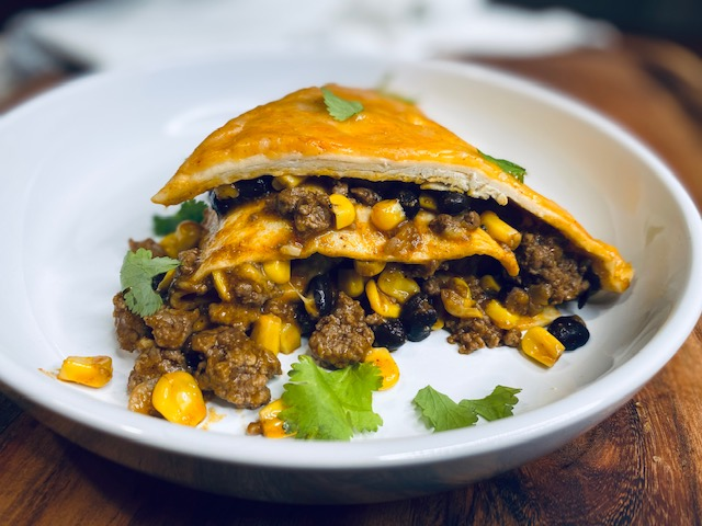 Lasagna with a Mexican twist on a white plate