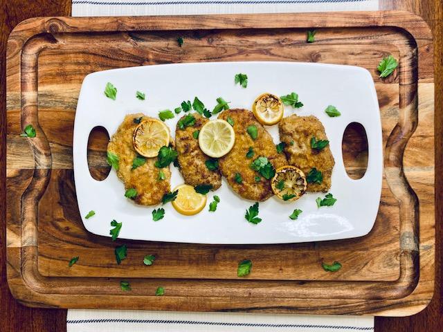 Pork schnitzel on a wooden tray