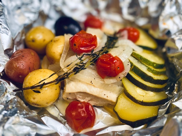 Grilled veggies and mahi with rosemary in foil