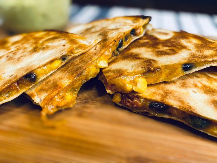 Quesadilla with chorizo on a cutting board