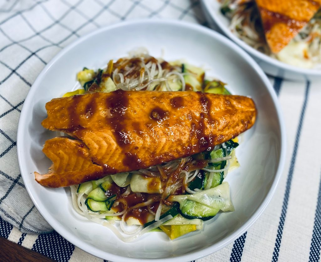 Noodle and squash salad with Thai salmon on top