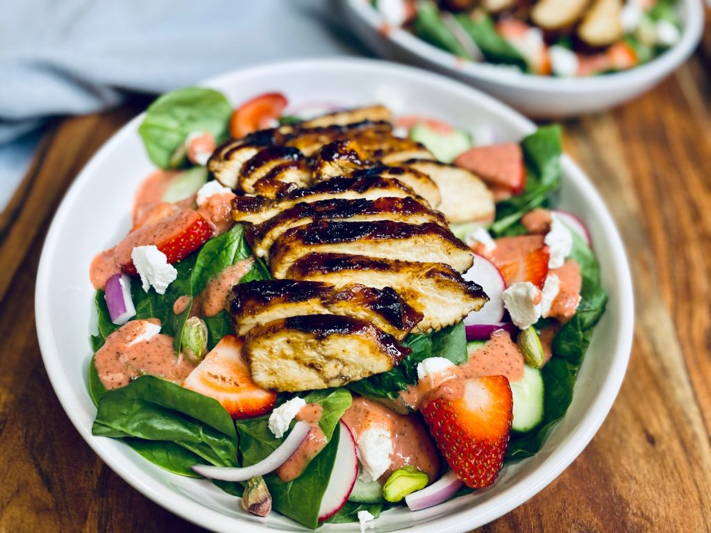 Strawberry summer salad on wooden board