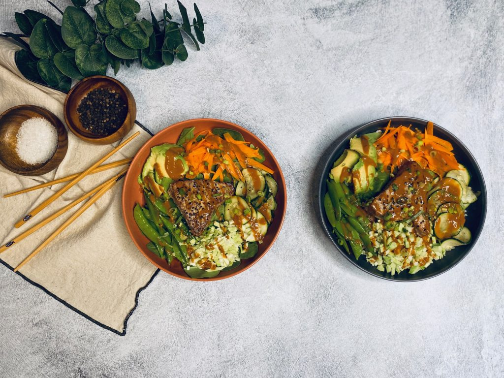 Two bowls with seared tuna and veggies