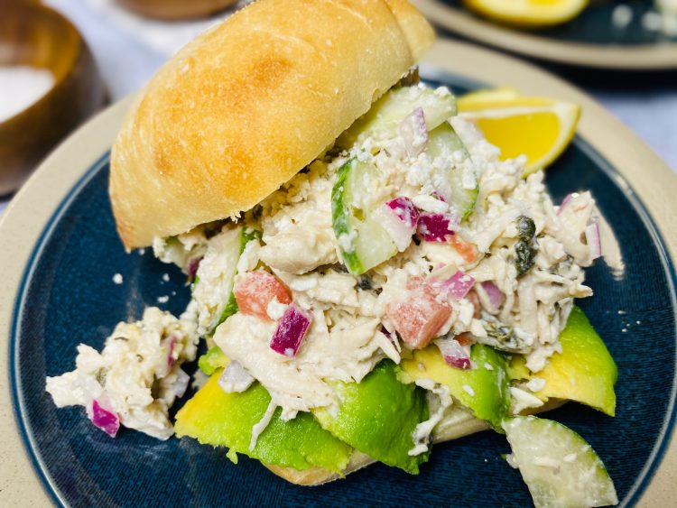 Greek chicken salad sandwich with avocado