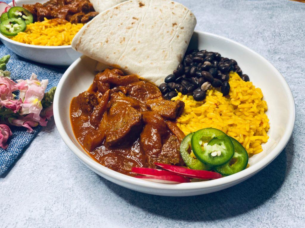 Concrete counter with a bowl of chili colorado