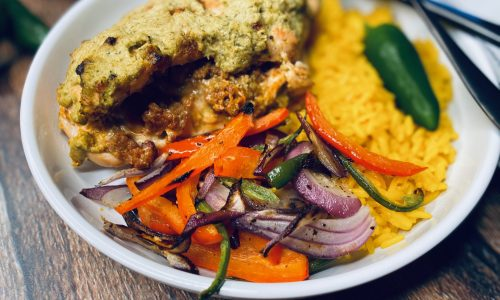 Jalapeño chicken stuffed with chorizo and cheese paired with veggies