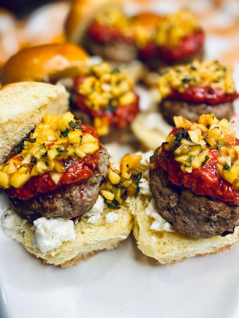 Turkey sliders with goat cheese and fruit topping