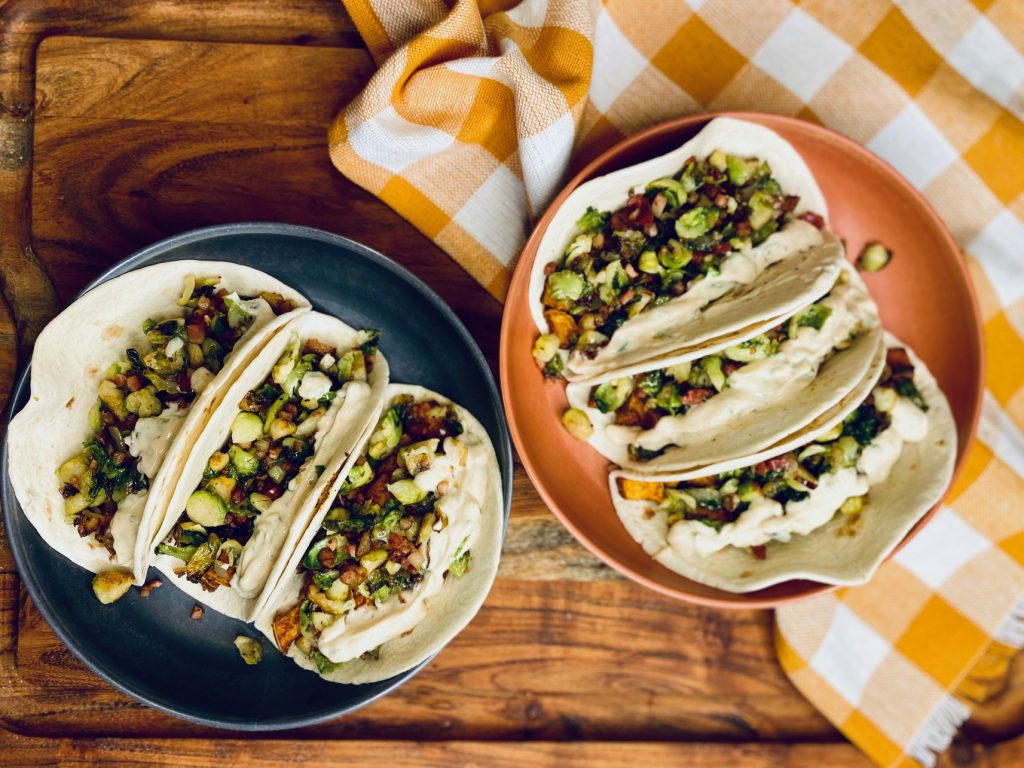 Wooden board with orange checkered napkin with tacos
