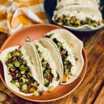 Sweet potato brussel tacos in a brown bowl